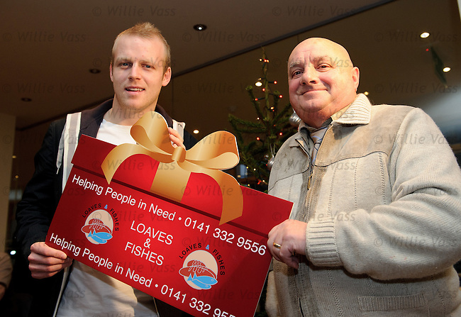 Rangers and Scotland star Steven Naismith sponsors a christmas lunch for Glasgow's homeless in conjunction with the Loaves and Fishes charity. Steven with Denis Curran at Renfield St Stephen's Church