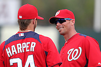 Washington Nationals center fielder Rick Ankiel talks with right fielder Bryce Harper #34 before a spring training game against the Houston Astros at Osceola County Stadium on March 3, 2012 in Kissimmee, Florida.  (Mike Janes/Four Seam Images)