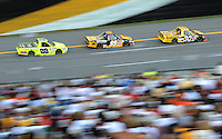 Oct 4, 2008; Talladega, AL, USA; NASCAR Craftsman Truck Series driver Todd Bodine (30) leads Erik Darnell (99) and Matt Crafton (88) during the Mountain Dew 250 at the Talladega Superspeedway. Mandatory Credit: Mark J. Rebilas-