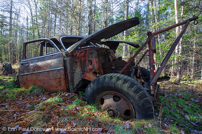 Abandoned 1950s Chevrolet in forest near Elbow Pond in Woodstock, New Hampshire USA.