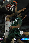 Michigan State University basketball player Durrell Summers, right, dunks over Connecticut defender Stanley Robinson during second half action.  MSU defeated UConn, 82-73.  Photo taken on Saturday, April 4, 2009, during the NCAA basketball semifinals at Ford Field in Detroit, Mich.  (The Oakland Press/Jose Juarez)