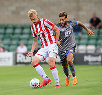 Stoke City's Lasse Sorensen shields the ball from Lincoln City's Jorge Grant<br /> <br /> Photographer Chris Vaughan/CameraSport<br /> <br /> Football Pre-Season Friendly - Lincoln City v Stoke City - Wednesday July 24th 2019 - Sincil Bank - Lincoln<br /> <br /> World Copyright © 2019 CameraSport. All rights reserved. 43 Linden Ave. Countesthorpe. Leicester. England. LE8 5PG - Tel: +44 (0) 116 277 4147 - admin@camerasport.com - www.camerasport.com
