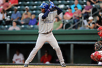 Outfielder Raimel Tapia (15) of the Asheville Tourists bats in a game against the Greenville Drive on Monday, April 21, 2014, at Fluor Field at the West End in Greenville, South Carolina. Tapia is the No. 10 prospect of the Colorado Rockies, according to Baseball America. Greenville won, 8-3. (Tom Priddy/Four Seam Images)