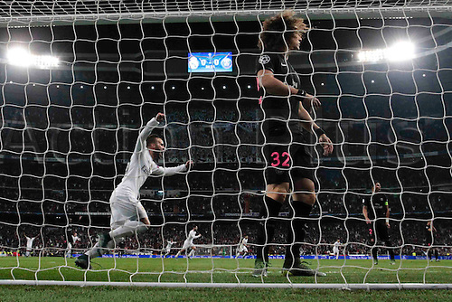 03.11.2015. Madrid, Spain.  Jose I. Fernandez Iglesias (6) Real Madrid's player  celebrates  after scoring his team´s goal as David Luiz (32) PSG looks on during the soccer match UCL Champions League between Real Madrid and PSG at the Santiago Bernabeu stadium in Madrid, Spain, November 3, 2015.