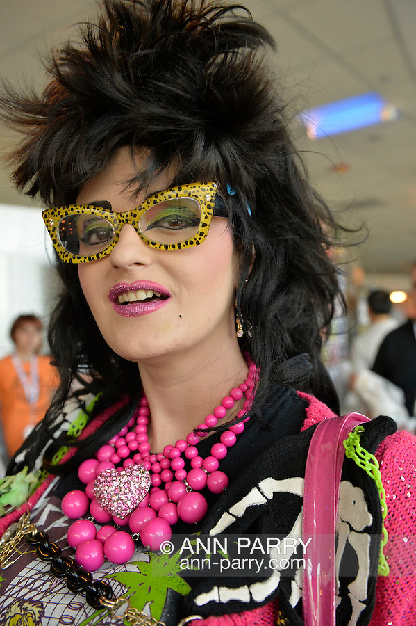 Garden City, New York, U.S. - June 14, 2014 - LINDSAY LOWE, the Pennsylvania TV personality of PA LIVE, cartoon fashions, wears colorful sunglasses and outfit at Eternal Con, the annual Pop Culture Expo, with costumes, Comic Books, Collectibles, Gaming, Sci-Fi, Cosplay, Horror, and held at the Cradle of Aviation Museum on Long Island.