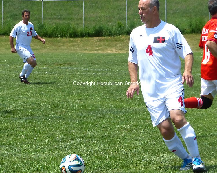 Joe Palladino photo<br /> <br /> Waterbury native Carlos Carlos, a member of the 1981 UConn men's soccer national championship team and former player with the New York Cosmos, competed this weekend in the first Pedro DeBrito Memorial Soccer Tournament at the Wilby High School athletic complex.