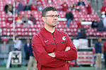 Dave Emerick, Chief of Staff of the Washington State University football team, watches warm ups prior to the Cougars Pac-12 Conference demolition of the Arizona Wildcats, 69-7, on November 5, 2016, at Martin Stadium in Pullman, Washington.
