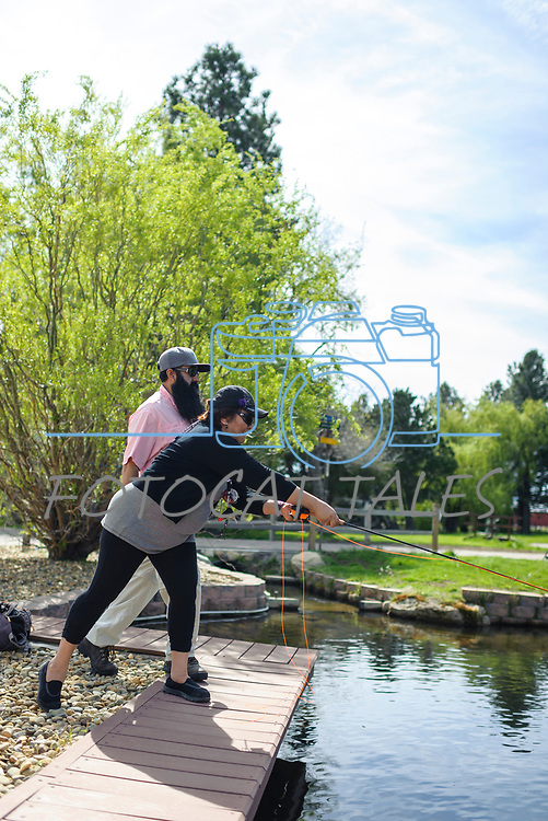 Maria Lopez learns to fly fish with the help of her River Buddy Jose Luna during the Casting for Recovery fishing clinic at Bently Ranch in Gardnerville, Nev. May 4, 2018.<br /> Photo by Candice Vivien/Nevada Momentum