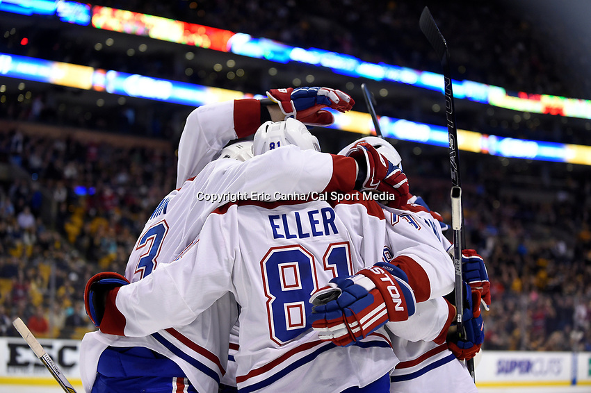 Saturday, October 10, 2105: Montreal Canadiens center Lars Eller (81) celebrates a second period goal with teammates  during the NHL game between the Montreal Canadiens and the Boston Bruins held at TD Garden, in Boston, Massachusetts. Eric Canha/CSM