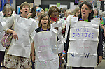 Jennifer Haines, Faith Reid, and Christine Reid lead a demonstration in favor of composting and other green practices during at the United Methodist Women Assembly in the Kentucky International Convention Center in Louisville, Kentucky, on April 25, 2014.