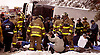 Rescue Workers triage victims from overturned bus accident on the southbound lane of N.J. Parkway just south of exit 63 in Stafford Twp. thatr occured on 2/7/03. At least person died in the accident which was blamed on the driver's speed.