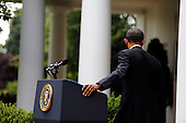 United States President Barack Obama departs after delivering a statement on Afghanistan in the Rose Garden of the White House, Washington DC, Tuesday May 27, 2014. He announced a plan to have about 10000 US troops staying in Afghanistan. <br /> Credit: Aude Guerrucci / Pool via CNP