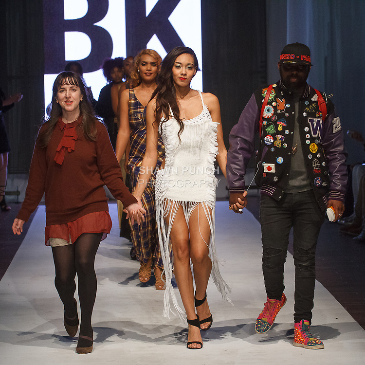 Fashion designer Alisha Trimble walks runway with models at the close of her Alisha Trimble Fall Winter 2017 collection fashion show, at the Brooklyn EXPO Center on April 1, 2017 during Fashion Week Brooklyn Fall Winter 2017.