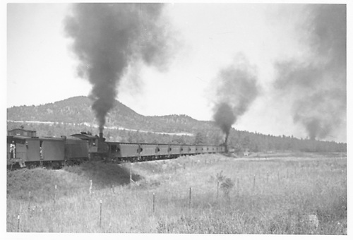 MT ore train heading uphill from Cripple Creek with a road engine and pusher.<br /> Midland Terminal