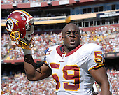 Landover, MD - October 12, 2008 -- Washington Redskins middle linebacker London Fletcher (59) celebrates a fumble recovery against the St. Louis Rams at FedEx Field in Landover, Maryland on Sunday, October 12, 2008.  The Rams won the game 19 - 17..Credit: Ron Sachs / CNP