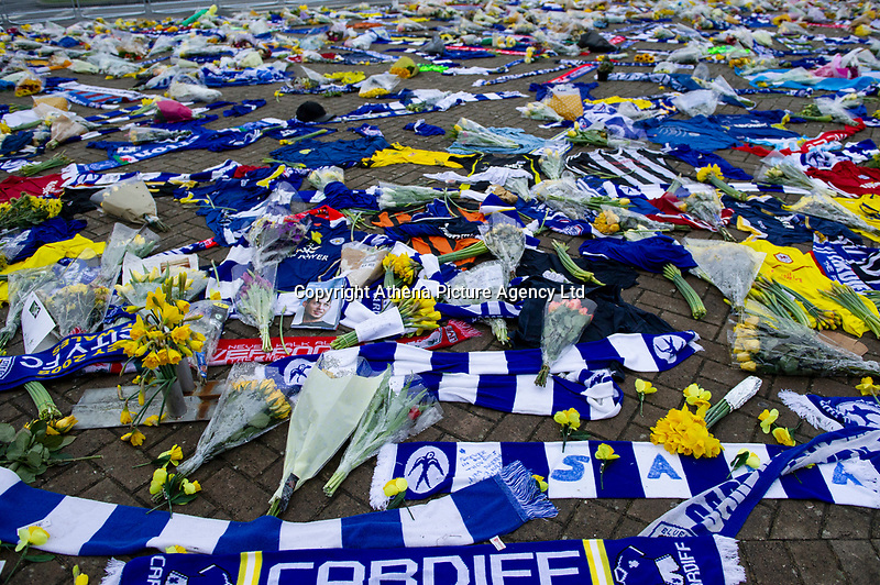 Pictured:  Tributes for Emiliano Sala outside the Cardiff City Stadium in Cardiff, South Wales, UK. Tuesday 05 February 2019<br /> Re: Attempts are being made to move a large part of the plane wreck that was carrying Cardiff City footballer Emiliano Sala and pilot David Ibbotson.<br /> <br /> A body was seen in the Piper Malibu N264DB on Monday, two weeks after it vanished over the English Channel.