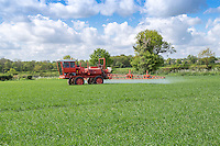 Spraying fungicide onto spring barley - Norfolk, May