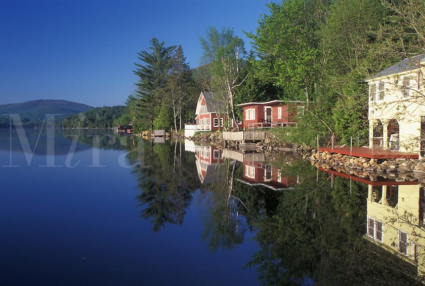 lake, cottages, summer, West Barnet, VT, Vermont, Reflection of summer cottages along Harveys Lake in West Barnet in the spring.