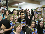 """Bold and the Beautiful Mario Lopez with his new book """"Extra Lean Family"""" - Get Lean and Achieve Your Family's Best Health Ever - at a book signing with fans on May 07, 2011 at Bookends, Ridgewood, New Jersey.  (Photo by Sue Coflin/Max Photos)"""