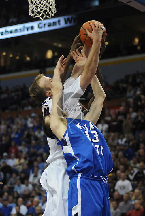 March 5,  2011         Indiana State Sycamores guard Jake Odum (13) and Missouri State Bears center Will Creekmore (44) go up for a rebound in the second half. Indiana State defeated MIssouri State 60-56 in the championship game of the NCAA Missouri Valley Conference Men's Basketball Tournament on Sunday March 6, 2011 at the Scottrade Center in downtown St. Louis.  They received an automatic bid to the NCAA Basketball Tournament