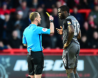 Lincoln City's John Akinde is shown a yellow card by referee Martin Coy<br /> <br /> Photographer Andrew Vaughan/CameraSport<br /> <br /> The EFL Sky Bet League Two - Stevenage v Lincoln City - Saturday 8th December 2018 - The Lamex Stadium - Stevenage<br /> <br /> World Copyright © 2018 CameraSport. All rights reserved. 43 Linden Ave. Countesthorpe. Leicester. England. LE8 5PG - Tel: +44 (0) 116 277 4147 - admin@camerasport.com - www.camerasport.com