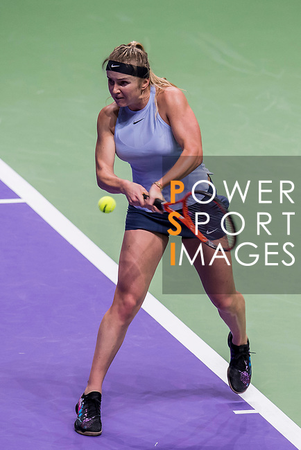 Elina Svitolina of Ukraine hits a shot in her singles match against Simona Halep of Romania during the BNP Paribas WTA Finals Singapore presented by SC Global at Singapore Sports Hub on 27 October 2017 in Singapore. Photo by Victor Fraile / Power Sport Images
