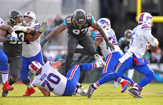 Jacksonville Jaguars defensive tackle Malik Jackson (97) leaps over Buffalo Bills center Eric Wood (70) to get after quarterback Tyrod Taylor (5) in a NFL Wildcard Playoff game Sunday, January 7, 2018 in Jacksonville, Fl.  (Rick Wilson/Jacksonville Jaguars)
