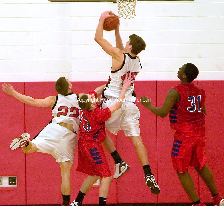 SOUTHBURY, CT-- 31  JANUARY 2008--013108JS14-Pomperaug's Chip Dylag (45) pulls down a rebound in front of Berlin's Richie Conway (33) and Jeremy Thompson (31) as well as teammate Chip Comeau (22) during their game Thursday at Pomperaug High School. <br /> Jim Shannon/Republican-American