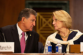 United States Senator Joe Manchin III (Democrat of West Virginia) and United States Senator Shelley Moore Capito (Republican of West Virginia) speak prior to the confirmation hearing of Daniel Bress to become a U.S. circuit judge for the ninth circuit, as well as the nomination of several district judges on Capitol Hill in Washington D.C., U.S. on May 22, 2019.<br /> <br /> Credit: Stefani Reynolds / CNP