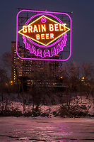 Historic Grain Belt Beer sign along the Mississippi River in downtown Minneapolis, Minnesota. The sign is lit in Purple and gold to celebrate the Minnesota Vikings playoff run. The sign was refurbished in late 2017.