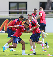 Alex Olade-Chamberlain & Phil Jones (Manchester United) of England during an open England football team training session at Stade Omnisport, Croissy sur Seine, France  on 12 June 2017 ahead of England's friendly International game against France on 13 June 2017. Photo by David Horn/PRiME Media Images.