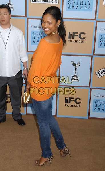 GARCELLE BEAUVAIS-NILON.21st IFP Independent Spirit Awards held at .Santa Monica Beach, Santa Monica,. California, USA, 04 March 2006..full length orange top jeans back rear.Ref: ADM/LF.www.capitalpictures.com.sales@capitalpictures.com.© Capital Pictures.