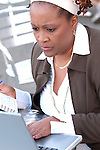 African American woman working on laptop, concentrating