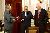 United States Senate Minority Leader Chuck Schumer (Democrat of New York), center, engages in conversation with US House Majority Leader Kevin McCarthy (Republican of California), left, as US Senate Majority Whip John Cornyn (Republican of Texas), right, looks on prior to the arrival of President Donald Trump at a reception for US House and US Senate Republican and Democratic leaders in the State Dining Room of the White House in Washington, DC on Monday, January 23, 2017.<br /> Credit: Ron Sachs / Pool via CNP