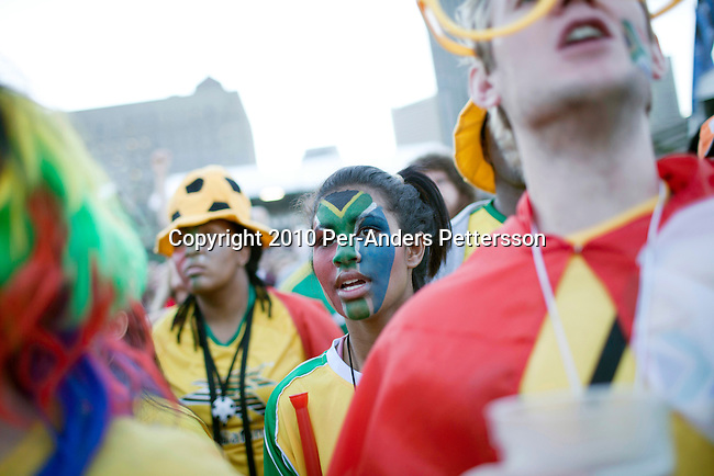 CAPE TOWN, SOUTH AFRICA - JUNE 22: Soccer fans react to a game between South Africa and France shown on giant monitors  on June 22, 2010, in central Cape Town, South Africa. Thousands of fans came to support the host nation South Africa in the 2010 World Cup soccer in South Africa. South Africa beat France 2-1 but both teams were eliminated in the group stage. In hosting the largest sporting event in the world, South Africa has a chance to impress the world with their beautiful and friendly country, hoping that the month long event will bring long lasting benefits for the country. (Photo by Per-Anders Pettersson)