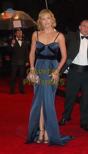 CHARLIZE THERON.The 2006 Orange British Academy Film Awards, Odeon Leicester Square, London, UK..February 19th, 2006.Ref: BEL.full length blue dress slit split purple clutch purse bafta baftas.www.capitalpictures.com.sales@capitalpictures.com.© Capital Pictures.