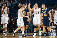 NORFOLK, VA--Toni Kokenis congratulates teammate Joslyn Tinkle during play against West Virginia University at the Ted Constant Convocation Center at Old Dominion University for the second round of the 2012 NCAA Championships. The Cardinal advanced to the West Regionals in Fresno with a score of 72-55.