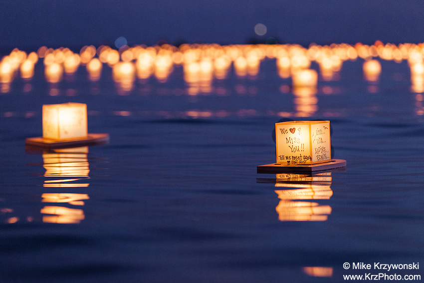 Lanterns floating in the water at night during the 15th Annual Lantern Floating Ceremony at Ala Moana Beach Park in Honolulu on Memorial Day