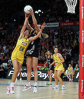 19.09.2013 Silver Ferns Irene Van Dyk and Australian Diamonds Laura Geitz in action during the Silver Ferns V Australian Diamonds New World Netball Series played at Vector Arena in Auckland. Mandatory Photo Credit ©Michael Bradley.