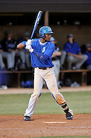 Center fielder Dominique Jackson (16) of the Spartanburg Methodist College Pioneers hits in a junior college game against Surry Community College on January 31, 2016, at Mooneyham Field in Spartanburg, South Carolina. (Tom Priddy/Four Seam Images)