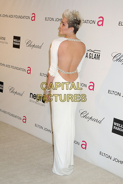 Miley Cyrus (wearing Azzaro).21st Annual Elton John Academy Awards Viewing Party held at West Hollywood Park, West Hollywood, California, USA..February 24th, 2013.oscars full length dress white long sleeves diamond bracelets chains straps backless back behind rear looking over shoulder .CAP/ADM/BP.©Byron Purvis/AdMedia/Capital Pictures.