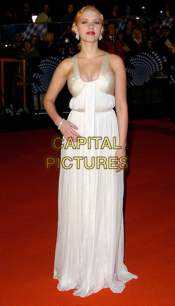 """SCARLETT JOHANSSON.""""The Prestige"""" UK film premiere.Odeon West End cinema, Leicester Square.5th November 2006 London, England.Ref: CAN .full length Amanda Wakeley cream white dress tulle gown hand on hip .www.capitalpictures.com.sales@capitalpictures.com.©Phil Loftus/Capital Pictures"""