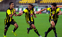 Sarpreet Singh (left) and Liberato Cacace (right) congratulate David Williams on his goal during the A-League football match between Wellington Phoenix and Brisbane Roar at Westpac Stadium in Wellington, New Zealand on Saturday, 22 December 2018. Photo: Dave Lintott / lintottphoto.co.nz