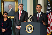 From left to right: United States Attorney General Loretta Lynch, left, and US Secretary of State John Kerry, center, look on as US President Barack Obama makes a statement after meeting with his National Security Council at the State Department, February 25, 2016 in Washington, DC. The meeting focused on the situation with ISIS and Syria, along with other regional issues.<br /> Credit: Drew Angerer / Pool via CNP