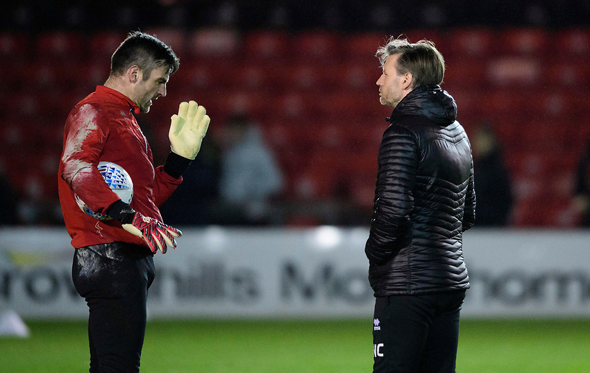 Lincoln City's Matt Gilks, left, and Lincoln City's assistant manager Nicky Cowley during the pre-match warm-up<br /> <br /> Photographer Chris Vaughan/CameraSport<br /> <br /> The EFL Sky Bet League Two - Lincoln City v Yeovil Town - Friday 8th March 2019 - Sincil Bank - Lincoln<br /> <br /> World Copyright © 2019 CameraSport. All rights reserved. 43 Linden Ave. Countesthorpe. Leicester. England. LE8 5PG - Tel: +44 (0) 116 277 4147 - admin@camerasport.com - www.camerasport.com
