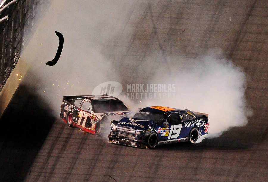 Jul. 3, 2010; Daytona Beach, FL, USA; NASCAR Sprint Cup Series drivers Sam Hornish Jr. (77) and Elliott Sadler (19) crash during the Coke Zero 400 at Daytona International Speedway. Mandatory Credit: Mark J. Rebilas-