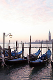 ITALY, Venice.  A view of gondola's at the dock off Piazza San Marco. The island of San Giorgio Maggiore can be seen in the distance, dominated by the tower and dome of the Church of San Giorgio Maggiore.