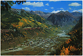 An elevated color postcard view of Telluride.  The caption reads: &quot;Telluride, located high in the San Juan Mountains, is one of Colorado's most famous mining towns.&quot;<br /> Telluride, CO  Taken by Reid, Homer