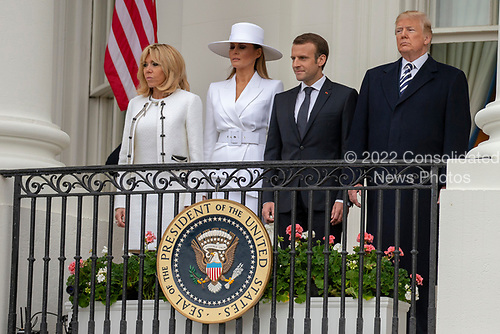 United States President Donald J. Trump, French President Emmanuel Macron, first lady of the United States Melania Trump, and first lady of France Brigette Macron, stand on the Truman Balcony of the White House 24, 2018 in Washington, DC. Credit: Alex Edelman / Pool via CNP