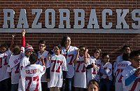 NWA Democrat-Gazette/CHARLIE KAIJO Kids from an after school program called SOAR line up to take a picture ahead of a football game on Friday, November 24, 2017 at Razorback Stadium in Fayetteville.